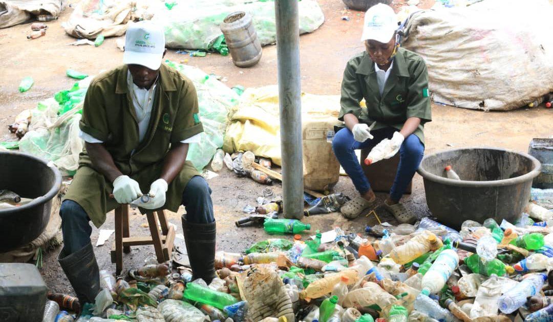 Men selecting PET plastics